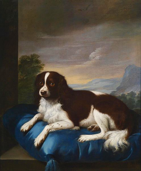 An oil painting of a Springer Spaniel resting on a royal blue pillow with a painted mountain scene in the background.
